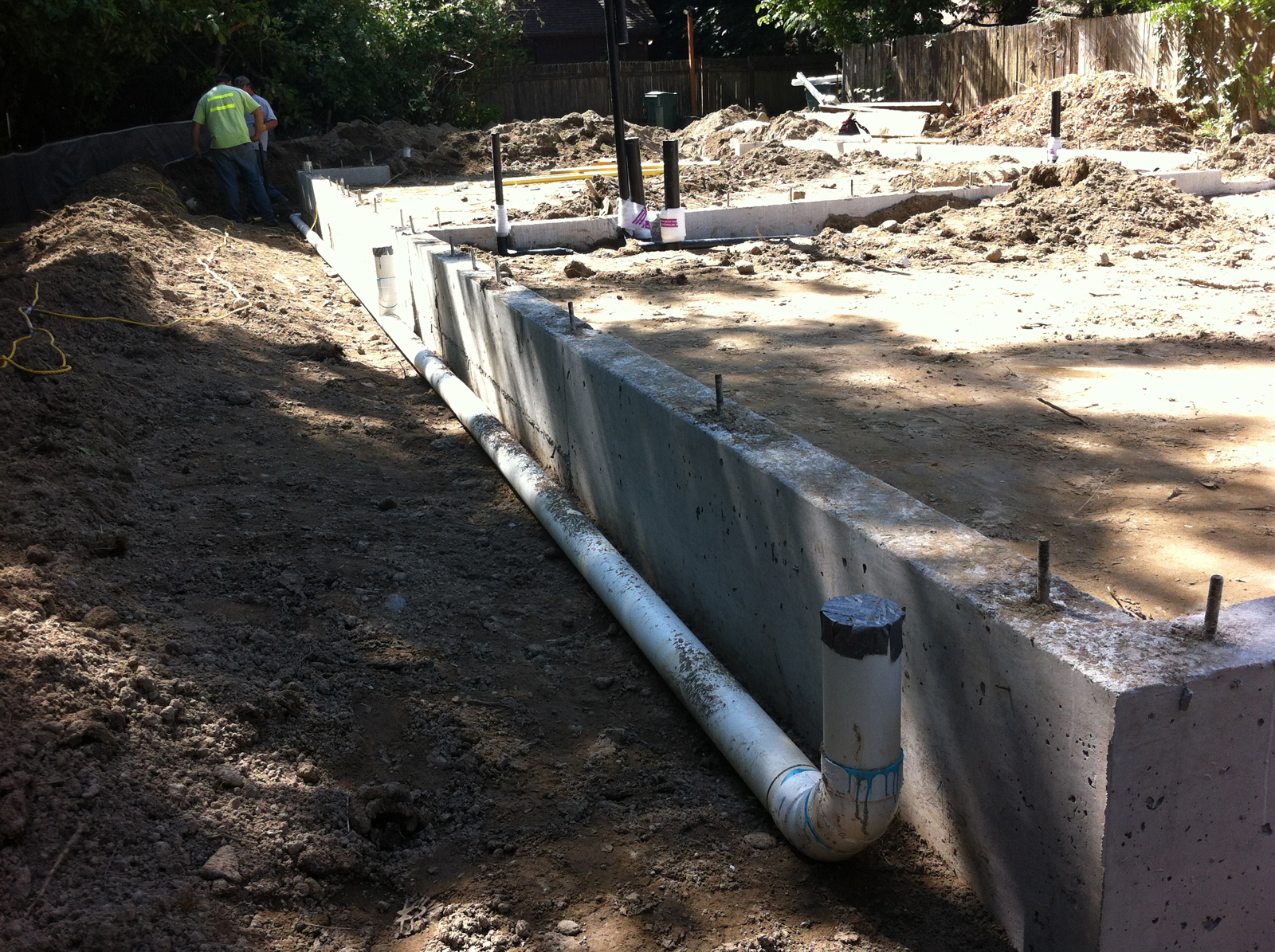 Case study house lessons in concrete plumbing build blog for Downspout drain
