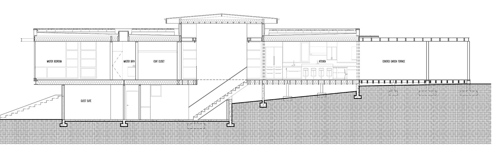 The roof assemblies at the wings on either side use parapet walls and a single ply membrane sloped ¼ vertical to 12 horizontal just like at the