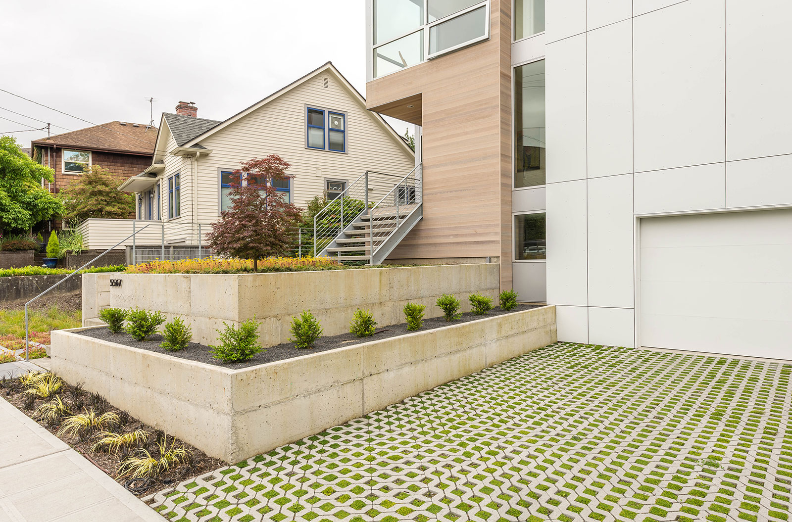 The driveway uses turf stone from mutual materials which satisfies the citys stormwater infiltration code and brings color and texture to the front of the